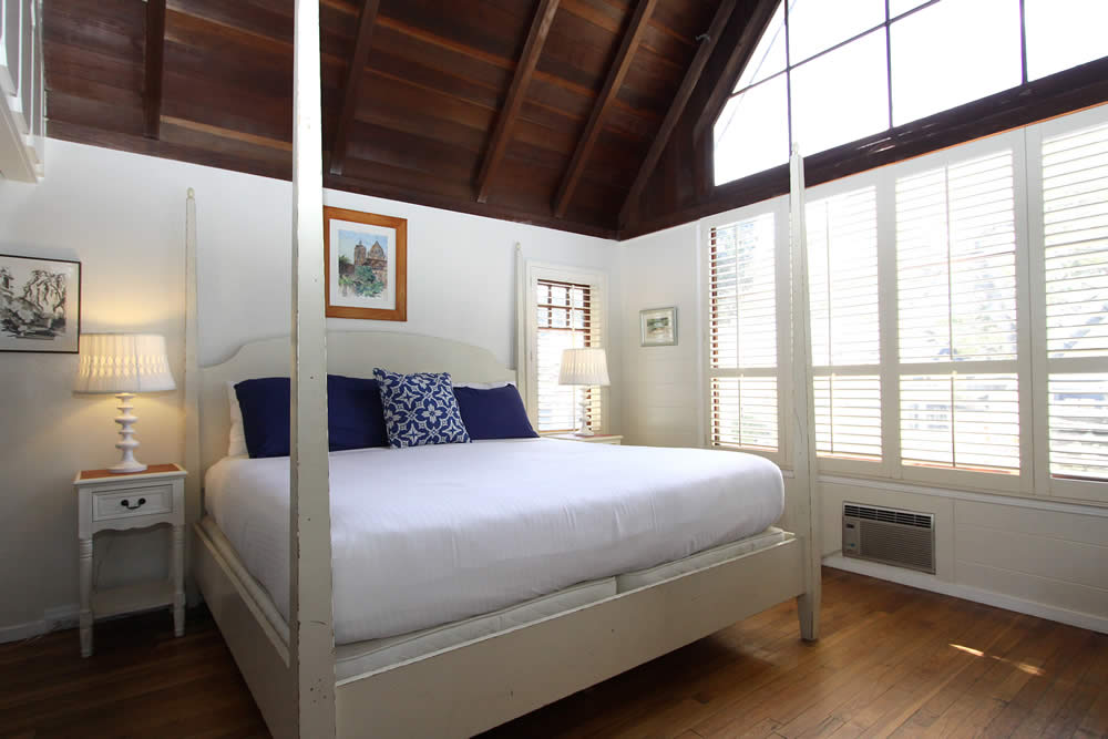 four poster bed, chairs, tall windows