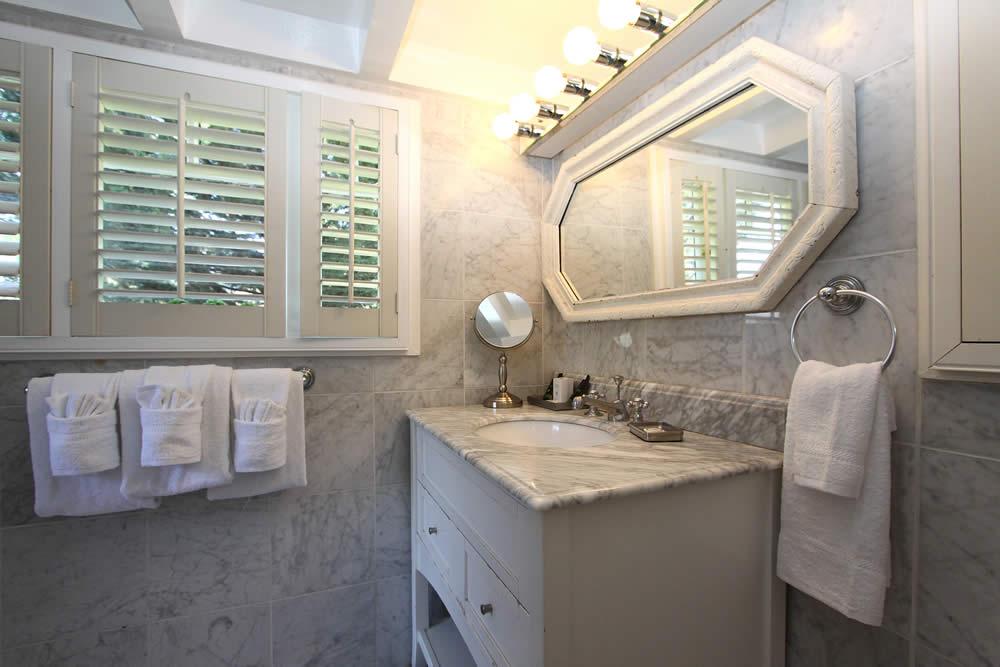 bathroom sink, mirro, marble floors