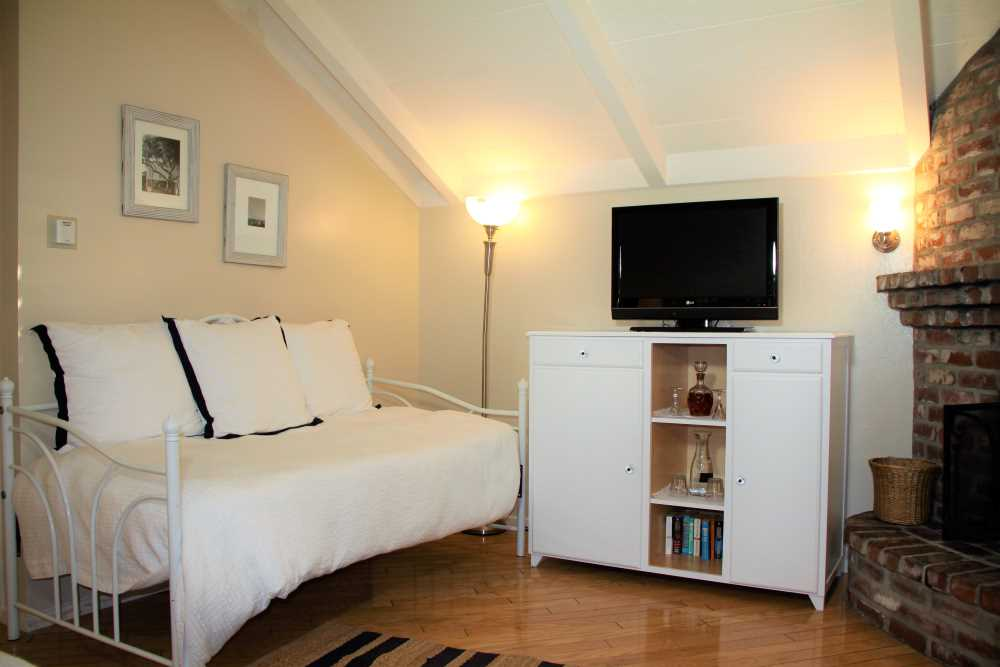 day bed, cabinet, and TV