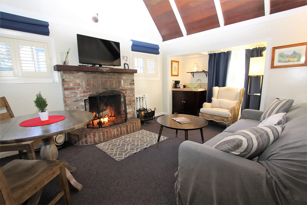 carmel boutique inns: cottage with one bedroom, spa-type bathroom, living rooms with TV and fireplace