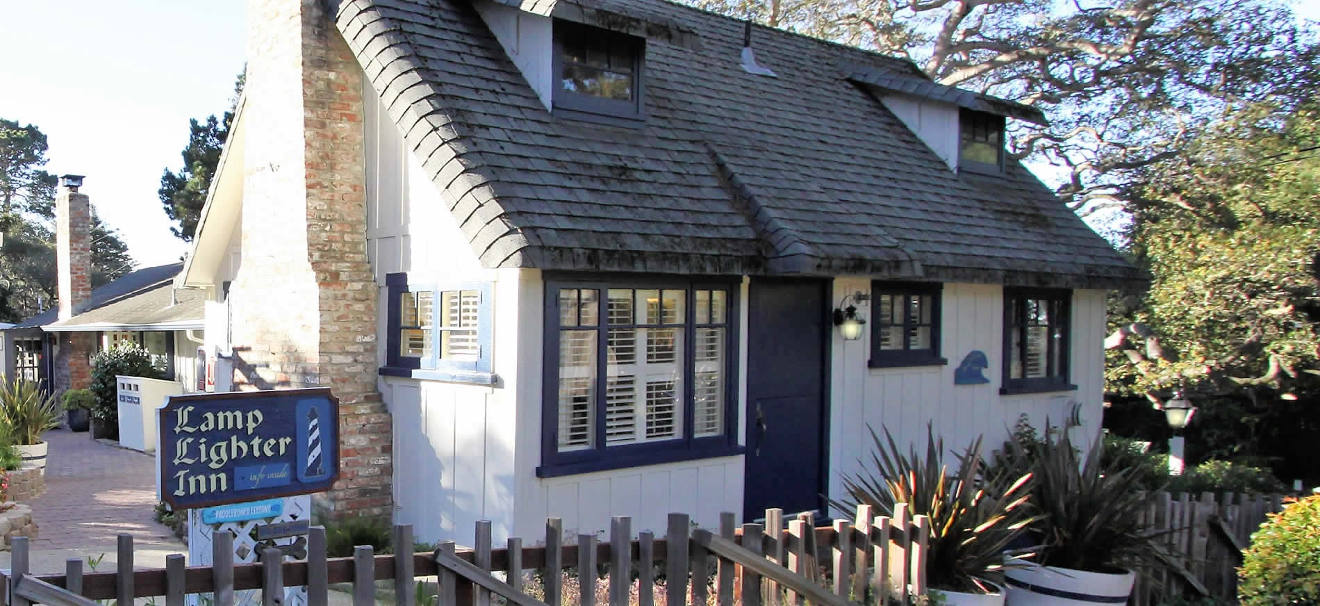 carmel boutique hotel cottage with picket fence