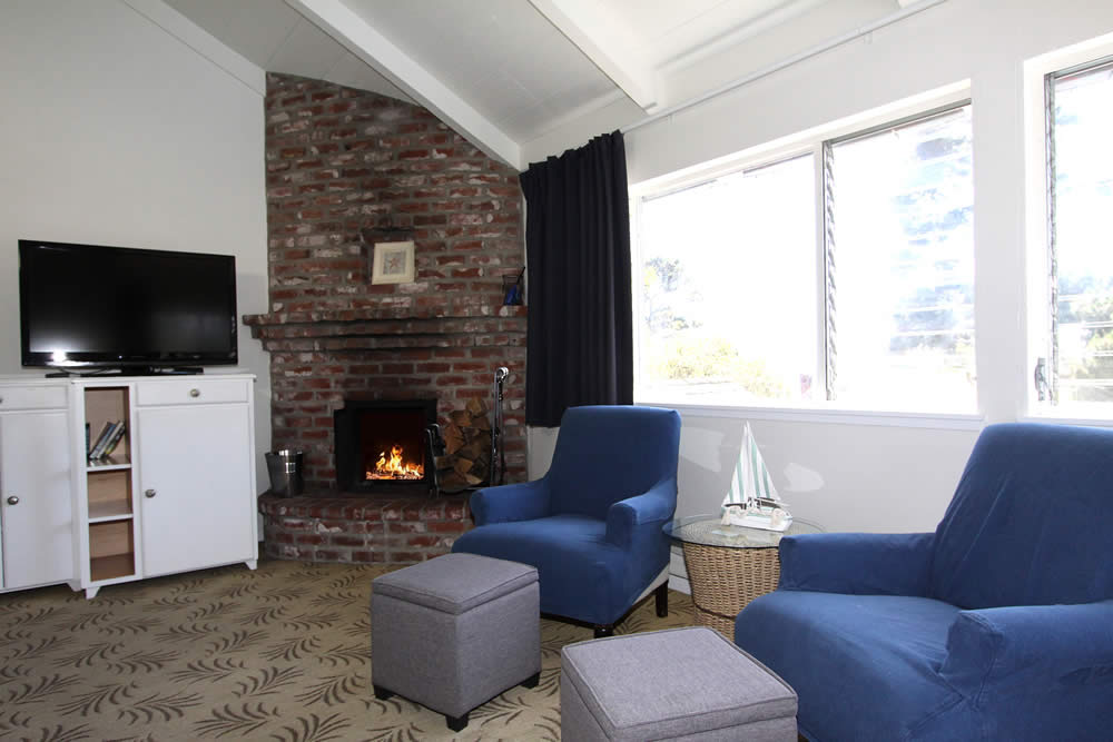 chairs, fireplace and TV