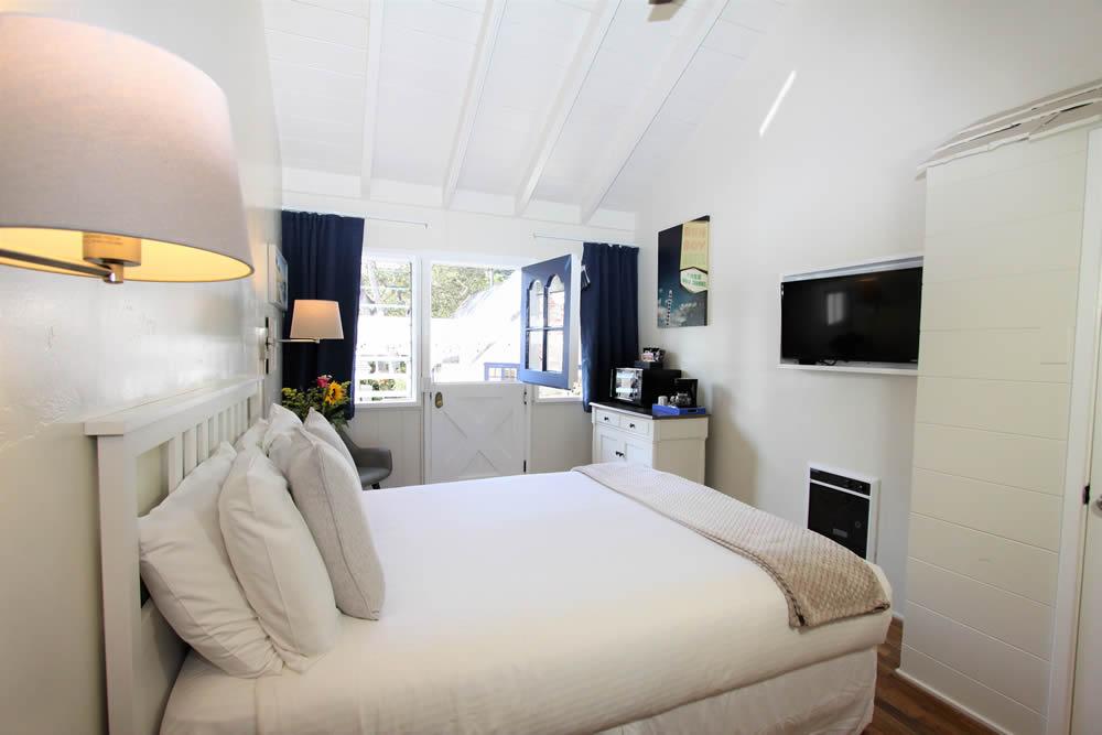 katydid room with bed and dutch door