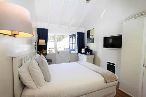 carmel boutique inn guestroom - bed, TV and dutch door